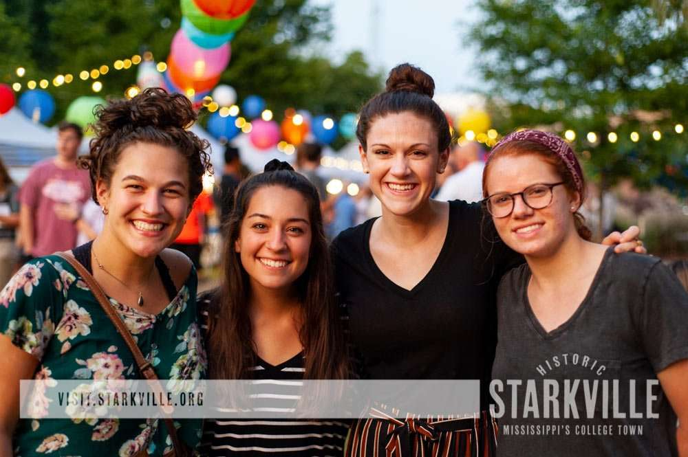 Young women smiling at the Night Market